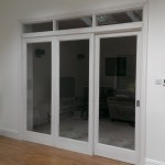 Room divider with sliding door
