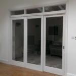 Room divider with sliding door